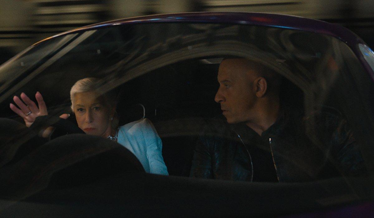 Helen Mirren drives as Vin Diesel watches in F9.