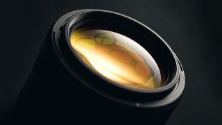 A camera lens reflecting the Raspberry Pi logo