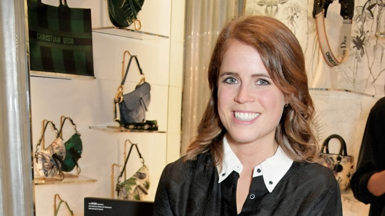 Princess Eugenie poses at an event