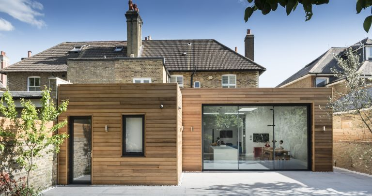 home insurance: Clad extension with sliding doors and a separate door to outside