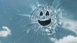 A broken glass smiley face from Black Mirror.