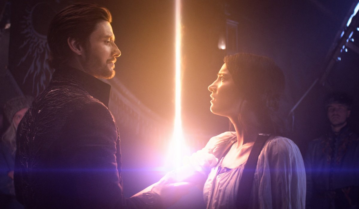 Ben Barnes and Jessie Mei Li stand around a very powerful light in Shadow and Bone