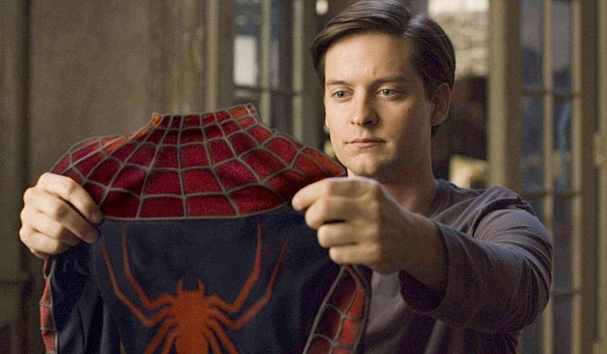 Spider-Man Tobey Maguire looking at his suit in the apartment