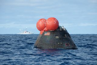 NASA's Orion spacecraft floats in the Pacific Ocean after its first uncrewed test flight on Dec. 5, 2014. The capsule was retrieved by the U.S. Navy's USS Anchorage.