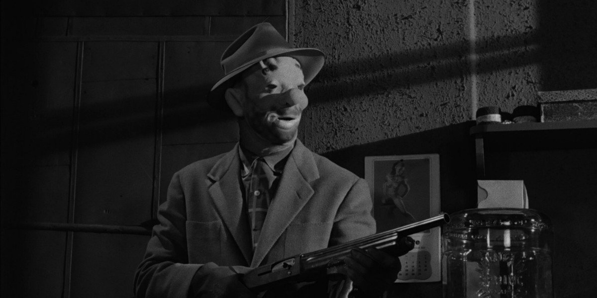 Wearing a clown mask to a heist in The Killing