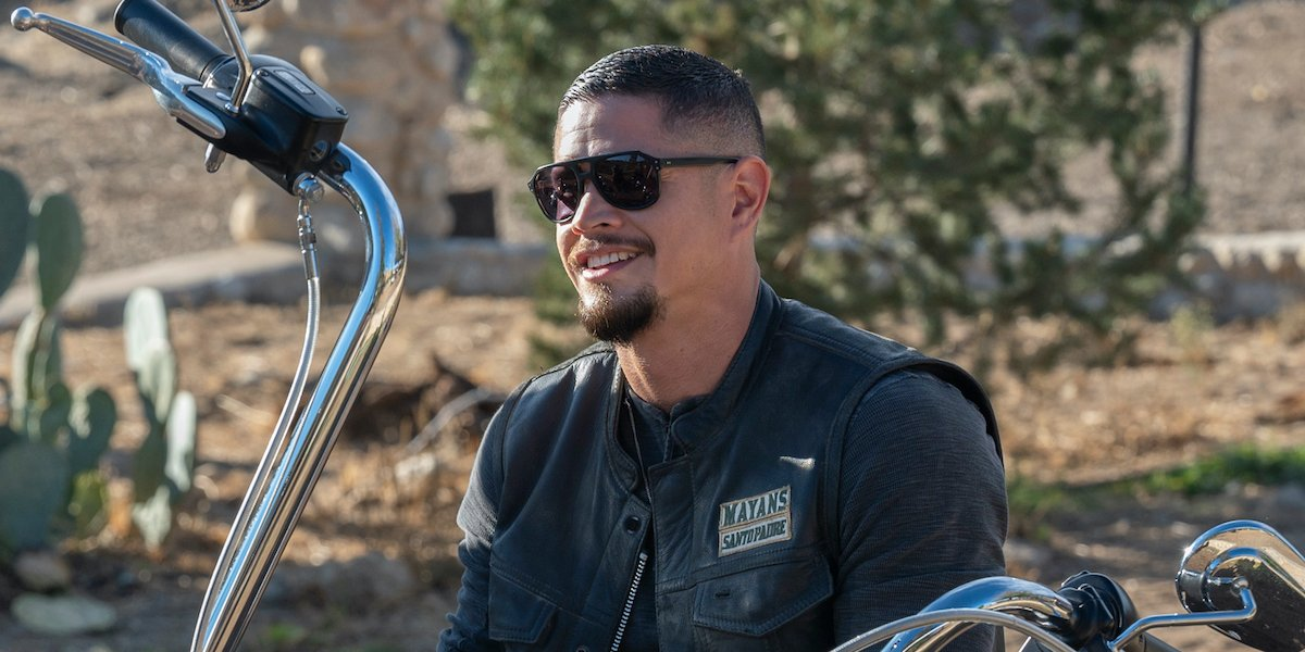 smiling ez reyes sitting on his motorcycle on Mayans MC