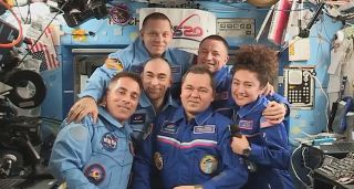 Clockwise from bottom left are International Space Station crewmembers Chris Cassidy, Anatoly Ivanishin, Ivan Vagner, Andrew Morgan, Jessica Meir and Oleg Skripochka. Morgan, Meir and Skripochka will leave the orbiting lab on April 16, 2020.
