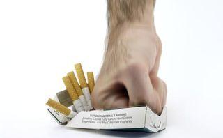 Hand smashing cigarettes