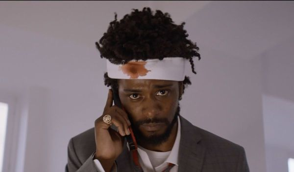 Lakeith Stanfield using a cell phone with a head wound in Sorry to Bother You