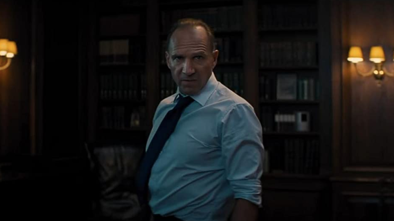 Ralph Fiennes looking angry in his office in No Time To Die.