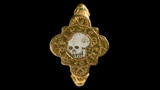 "This gold ""Memento Mori"" ring, dating to the Tudor period, sports an enamel skull."