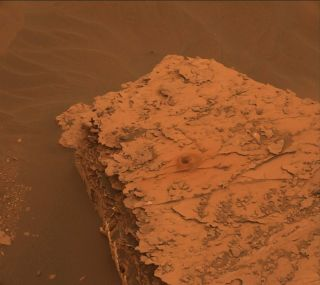 The massive dust storm on Mars has created some eerie views without shadows for NASA's Curiosity rover, like this image taken on June 17, 2018.