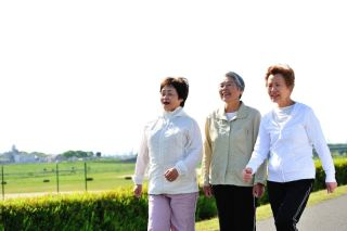 Three older women go walking together