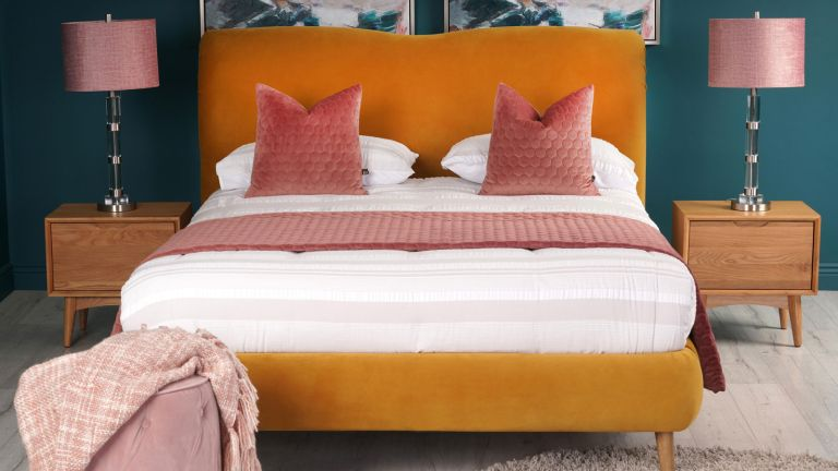 bed with orange headboard and frame