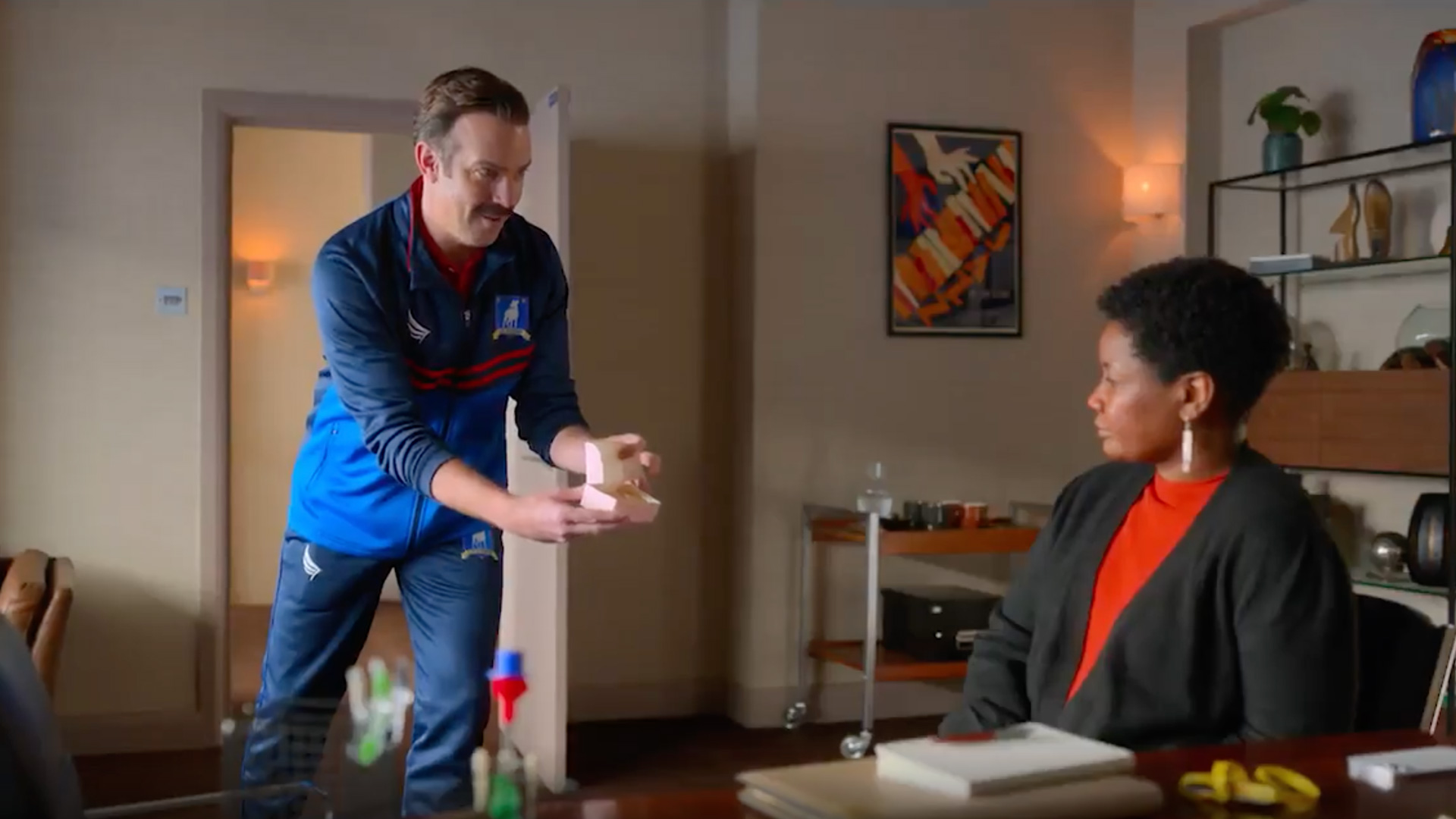 Ted Lasso offers Doctor Sharon Fieldstone some of his signature biscuits
