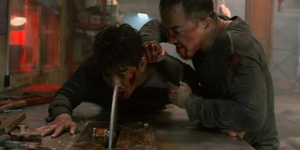 Joe Taslim pushing Iko Uwais into a buzz saw The Night Comes For Us