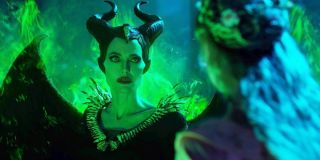 Maleficent: Mistress of Evil Maleficent glows green, and faces Aurora