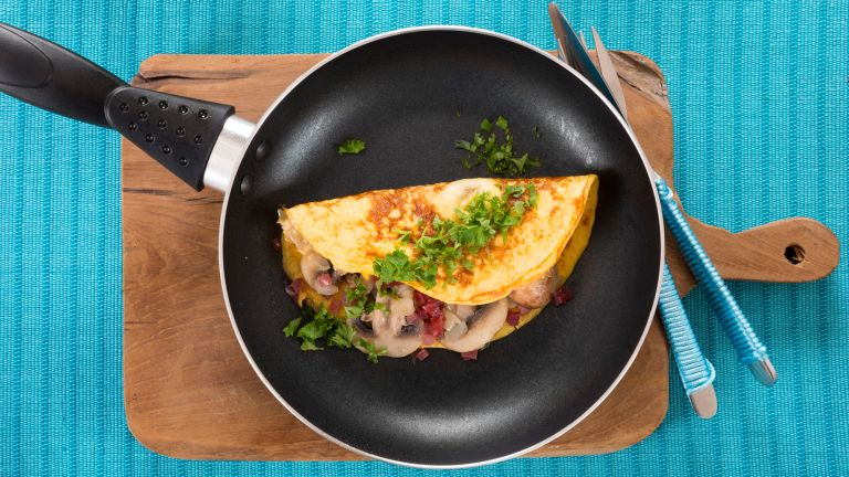 A vegetable filled omelette in a pan