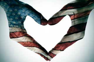 hands painted with the american flag in the shape of a heart.