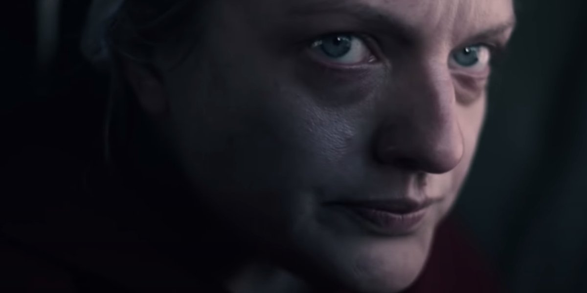 Elisabeth Moss showing worry on her face in The Handmaid's Tale.