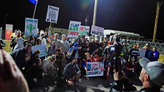 """Would-be alien-hunters gather to """"storm"""" Area 51 at an entrance to the military facility near Rachel, Nevada, on September 20, 2019."""