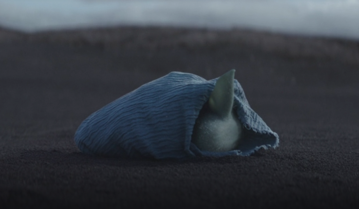 the mandalorian baby yoda wrapped in blanket