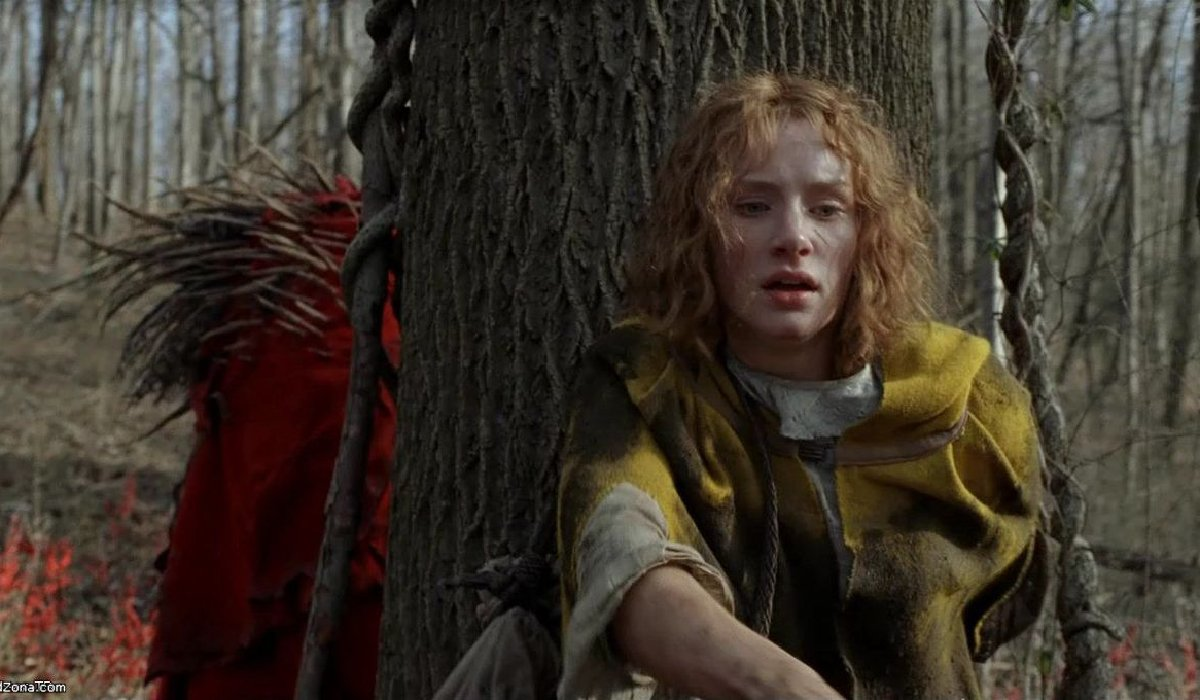 The Village Bryce Dallas Howard hides from a beast behind a tree