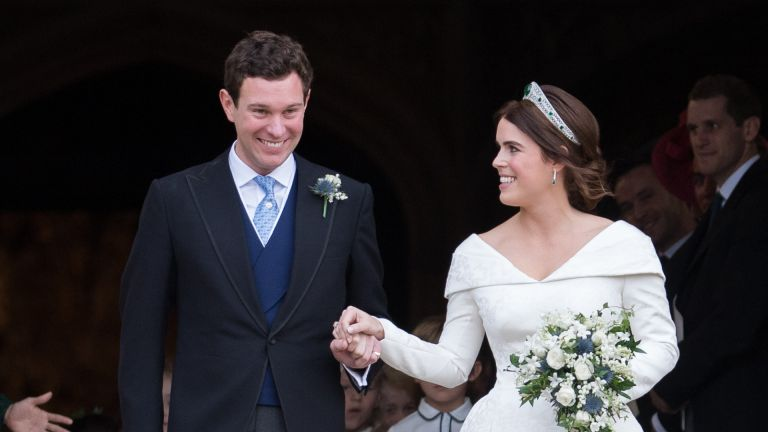 Princess Eugenie of York and Jack Brooksbank leave St George's Chapel in Windsor Castle following their wedding at St. George's Chapel on October 12, 2018