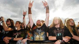 Metal fan throwing the horns at Bloodstock festival