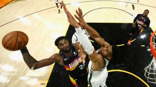 Deandre Ayton #22 of the Phoenix Suns attempts a shot over Giannis Antetokounmpo #34 of the Milwaukee Bucks in game two of the NBA Finals at Phoenix Suns Arena on July 8, 2021 in Phoenix, Arizona.