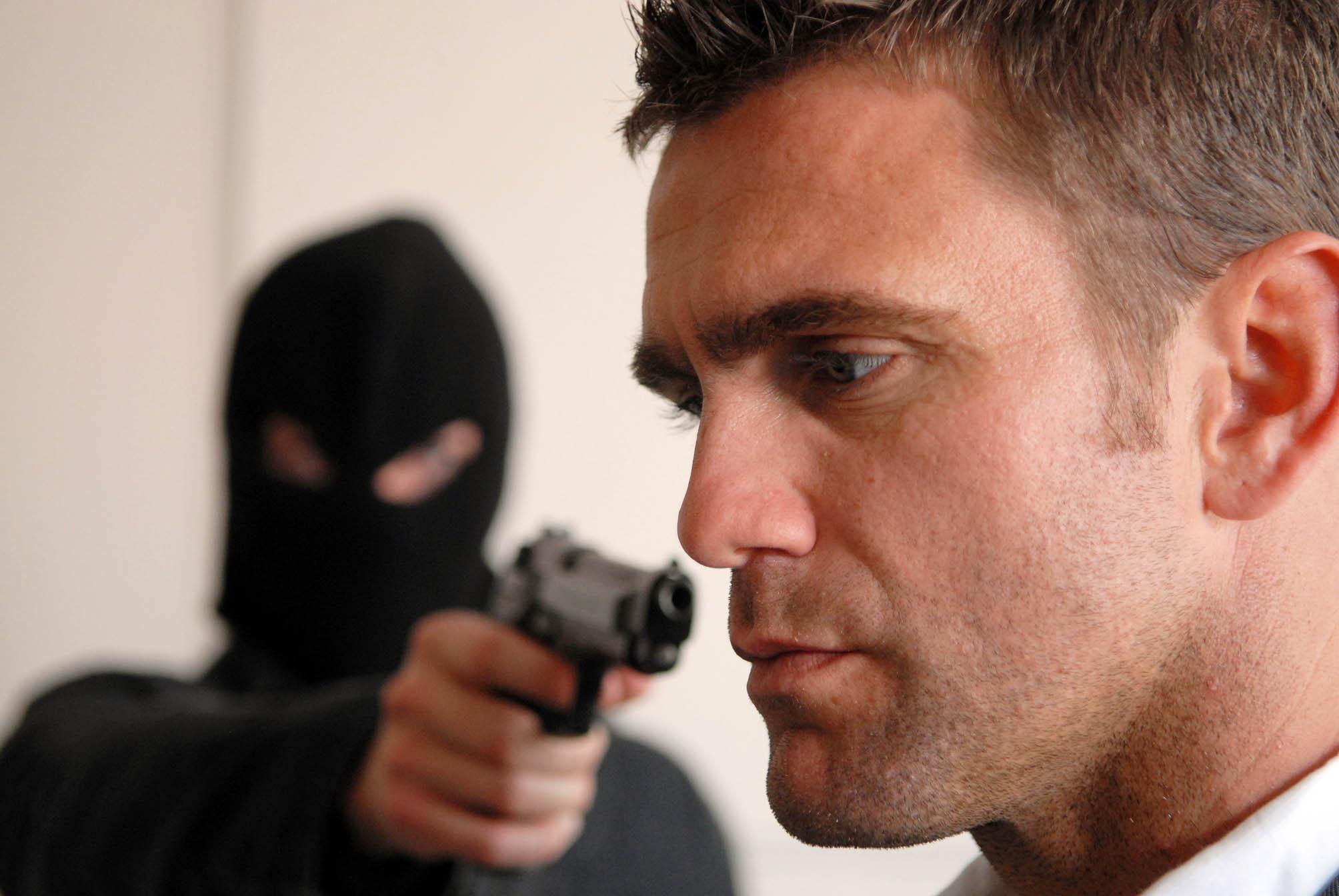Phil's held at gunpoint