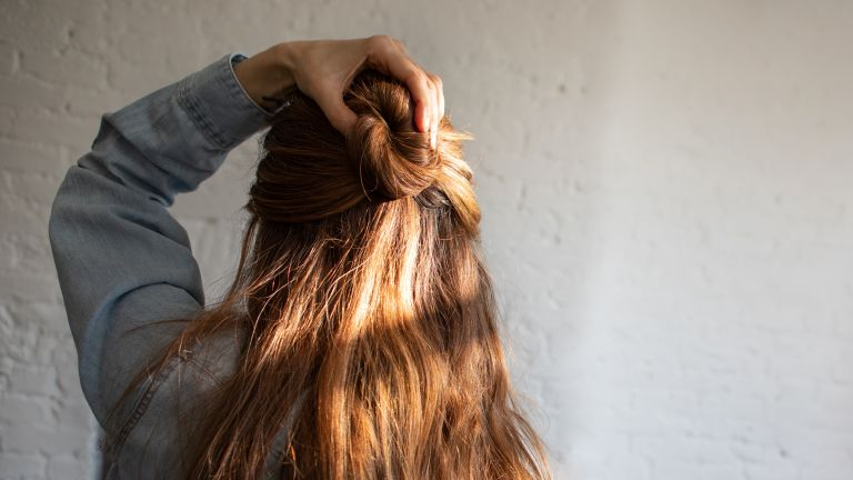 back view of woman with half up hairstyle