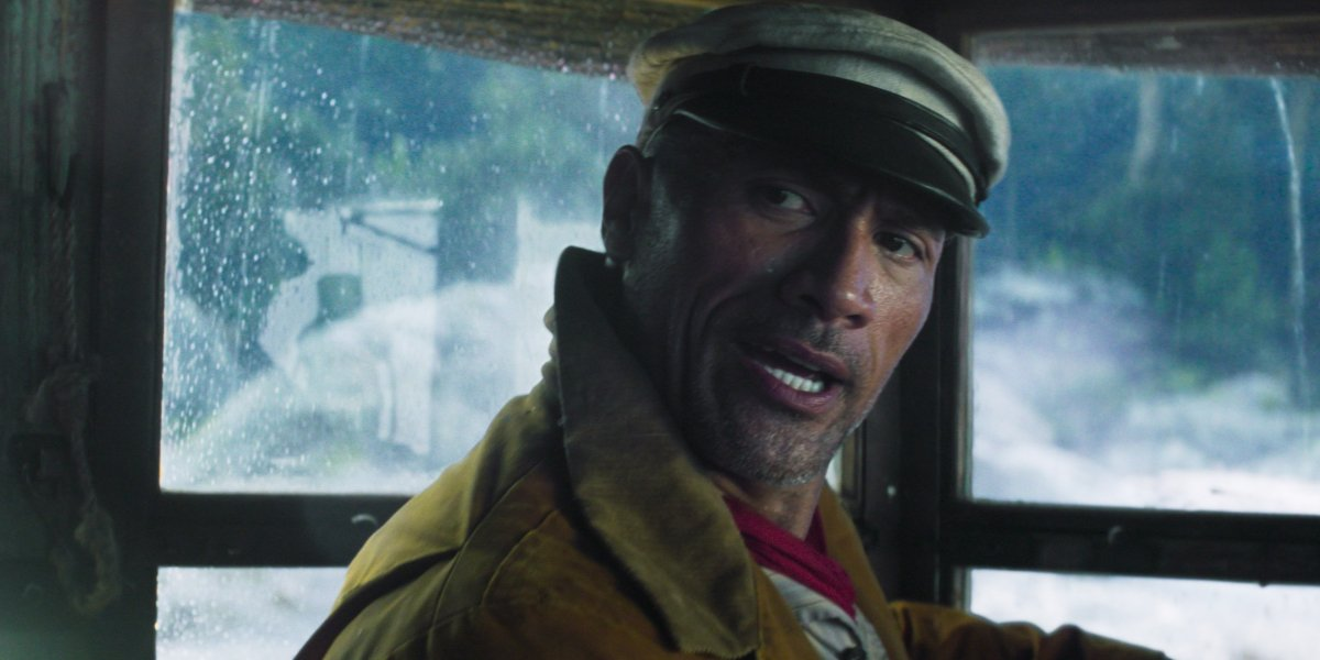 Dwayne Johnson at the controls during a rainy spell in Jungle Cruise.