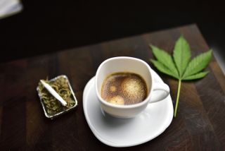 A coffee cup and a marijuana cigarette.