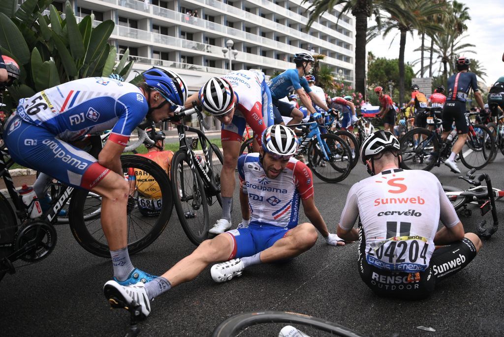 Team GroupamaFDJ rider Frances Thibaut Pinot C lies on the ground after a crash during the 1st stage of the 107th edition of the Tour de France cycling race 156 km between Nice and Nice on August 29 2020 Photo by AnneChristine POUJOULAT AFP Photo by ANNECHRISTINE POUJOULATAFP via Getty Images