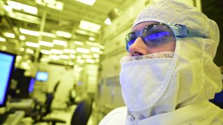 Intel employee in bunny suit working at fab plant