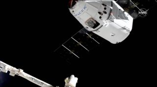 A previously flown Dragon cargo ship reaches the International Space Station m it's 5,000 pounds. on the CRS-18 mission for NASA on July 27, 2019.