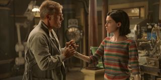 Alita: Battle Angel Dr. Ido holds Alita's hand in the lab