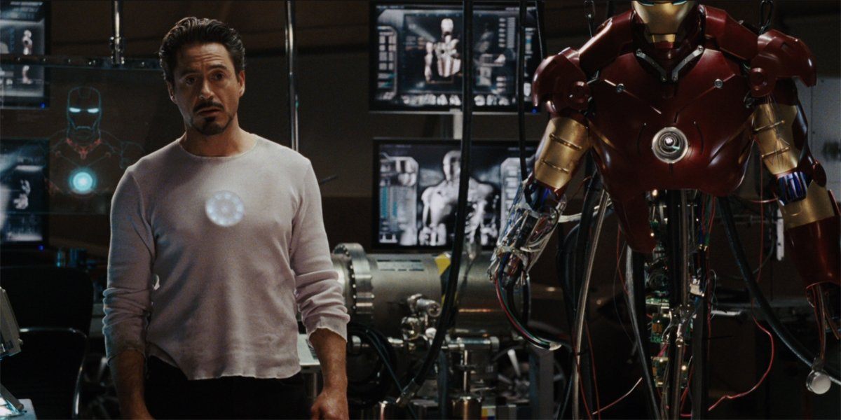 Iron Man stands in his lab