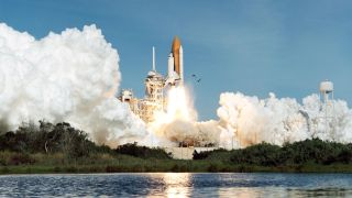 Space Shuttle Columbia launches on mission STS-62.