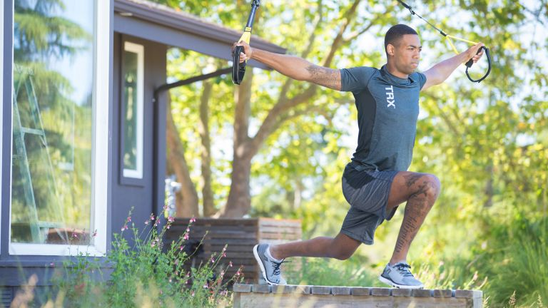 A man working out using the TRX Home2 suspension trainer