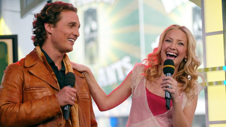 "NEW YORK - FEBRUARY 3: Actress Kate Hudson and actor Matthew McConaughey laugh during an appearance on ""TRL"" February 3, 2003 at the MTV Times Square Studios in New York City. (Photo by Scott Gries/Getty Images)"