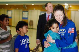 Astronaut Dyson Hugs Students