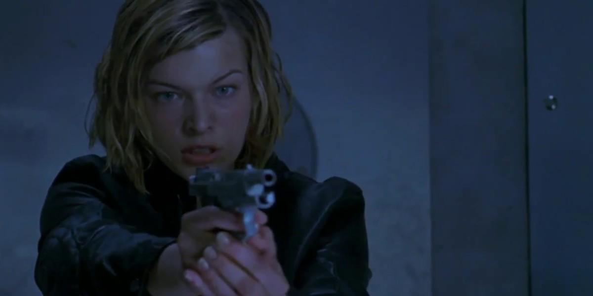 Milla Jovovich with a gun