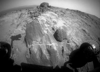 NASA's Mars rover Opportunity is taking a close look at the strange flat-faced rock near the center of this view, captured on March 3, 2015.