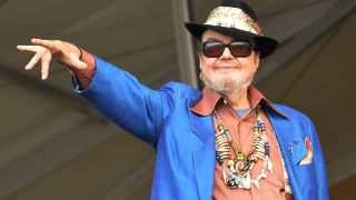 Dr John onstage, pointing to the crowd