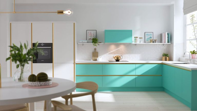 an l shape kitchen layout with green and white cabinets, wood accents, round dining table and wood chairs
