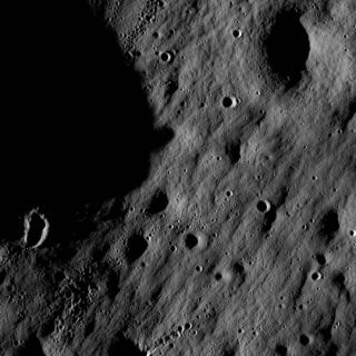 New Moon Orbiter Sends First Lunar Snapshots