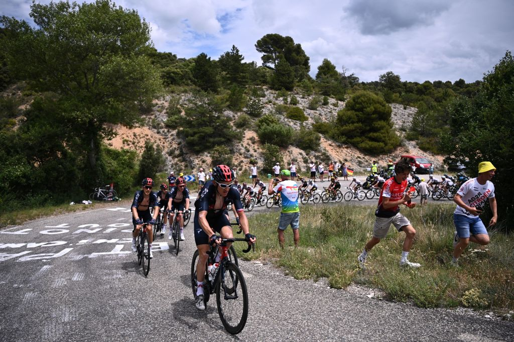 Team Ineos riders lead the pack during the 11th stage of the 108th edition of the Tour de France cycling race 198 km between Sorgues and Malaucene on July 07 2021 Photo by AnneChristine POUJOULAT AFP Photo by ANNECHRISTINE POUJOULATAFP via Getty Images