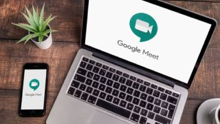 Computer and smartphone showing Google Meet app logo